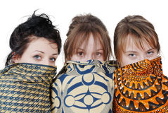 Portrait of three pretty girls with scarves Royalty Free Stock Photography