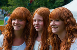 Portrait of three redheaded girls. BREDA, NETHERLANDS – SEPTEMBER 4, 2011 : Redhead Day for young and old in the Dutch city of Breda. Thousands of redheads Royalty Free Stock Image