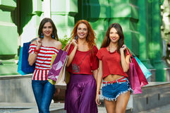 Portrait of three sisters with Shopping Bags Stock Images