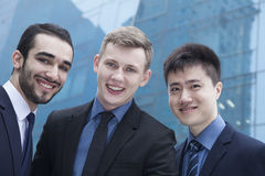 Portrait of three smiling businessmen, outdoors, business district Stock Photography