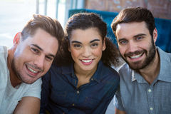 Portrait of three smiling friends. In the coffee shop Stock Photos