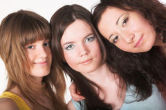 Portrait of three smiling girlfriends Royalty Free Stock Photography