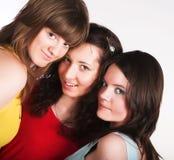 Portrait of three smiling girlfriends Stock Photos