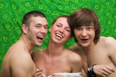 Portrait of three smiling young people. At home Royalty Free Stock Image