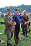 Portrait of three soldiers-reenactors in historical costumes. Royalty Free Stock Photos