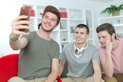 Portrait three university students taking selfie at home Stock Images