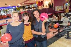 Portrait three women in bowling alley. Portrait of three women in bowling alley Royalty Free Stock Photography