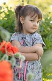 Portrait of a three year old little girl outdoor in  garden. Royalty Free Stock Photos
