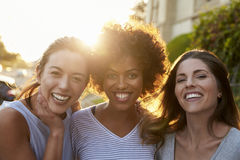 Portrait of three young adult female friends in the street Royalty Free Stock Photos