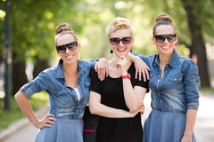 Portrait of three young beautiful woman with sunglasses Stock Images