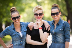 Portrait of three young beautiful woman with sunglasses Royalty Free Stock Photos