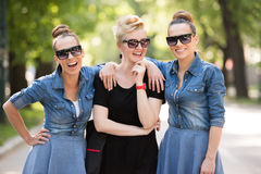 Portrait of three young beautiful woman with sunglasses Stock Photo