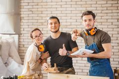Three young craftsmen ready to work Royalty Free Stock Images