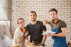 Three young craftsmen ready to work Royalty Free Stock Photography