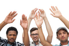 Portrait of three young men raising hands Stock Photography