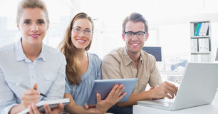 Portrait of three young people in office Stock Photo
