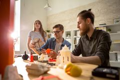 Group of Design Students Using 3D Printer royalty free stock photography