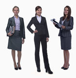 Portrait of three young smiling businesswomen, looking at camera, studio shot Royalty Free Stock Images