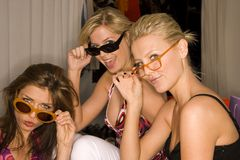 Portrait of three young women wearing sunglasses. Portrait of three posing young women wearing sunglasses Royalty Free Stock Photo