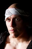 Portrait of a thug in headband at night Royalty Free Stock Photography