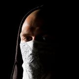 Portrait of a thug in mask at night Royalty Free Stock Images