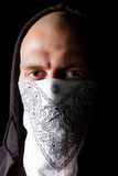 Portrait of a thug in mask at night Royalty Free Stock Photo