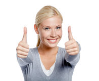 Portrait of thumbing up girl Stock Photography