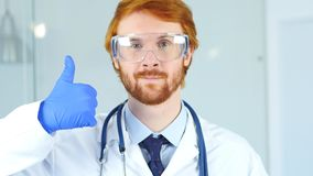 Portrait of Thumbs Up by Doctor in Gloves, Surgeon. 4k , high quality Royalty Free Stock Images