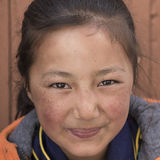 Portrait Tibetan Buddhist young girl in Hemis monastery, Ladakh, North India Royalty Free Stock Image