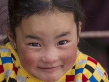 Portrait Tibetan Buddhist young girl in Hemis monastery, Ladakh, North India Stock Photography