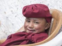 Portrait Tibetan Buddhist young monk in Hemis monastery, Ladakh, North India Stock Photo