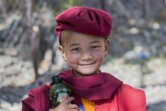 Portrait Tibetan Buddhist young monk in Hemis monastery, Ladakh, North India Royalty Free Stock Photo