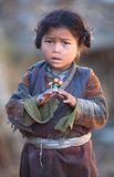 Portrait of tibetan girl. GORKHA, NEPAL - NOVEMBER 28: Portrait of Tibetan girl from the village of Tibetan refugees on November 28, 2009 in Gorkha District Stock Photos