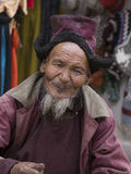 Portrait tibetan old man on the street in Leh, Ladakh. India. LEH, INDIA - JUNE 24, 2015: Unidentified tibetan old man on the street in Leh, Ladakh Royalty Free Stock Images