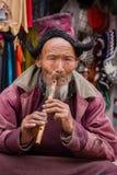 Portrait tibetan old man on the street in Leh, Ladakh. India. LEH, INDIA - JUNE 24, 2015: Unidentified tibetan old man on the street in Leh, Ladakh Stock Images