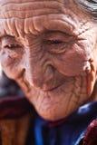Portrait of tibetan old woman. KATHMANDU - APRIL 03: Portrait of old tibetan woman praying near Stupa Boudhanath on April 03, 2010 in Kathmandu, Nepal Royalty Free Stock Photo