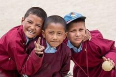Portrait tibetan three boys in Druk White Lotus School. Ladakh, Leh, India Royalty Free Stock Images