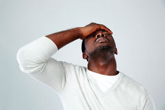 Portrait of a tired african man Stock Photo