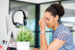 Portrait of tired afro-american office worker sitting in offfice Royalty Free Stock Photography