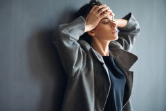Portrait of tired beautiful woman on dark background Stock Photography