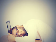 Portrait  of tired businessman sleeping on his laptop Royalty Free Stock Images