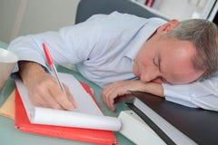 Portrait tired businessman sleeping on laptop Stock Photo
