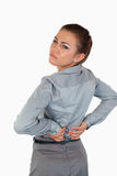 Portrait of a tired businesswoman having back pain Royalty Free Stock Images