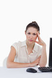 Portrait of a tired businesswoman using a computer Royalty Free Stock Images