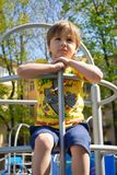 Portrait tired cute boy on the playground Stock Photo