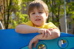 Portrait tired cute boy on the playground Royalty Free Stock Image