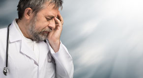 Portrait of a tired doctor Royalty Free Stock Image