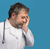 Portrait of a tired doctor Stock Photos