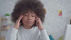 Portrait tired and exhausted african american students woman with an afro hairstyle. At home stock footage