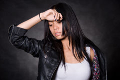 Portrait of tired girl with a hand on a forehead Royalty Free Stock Image